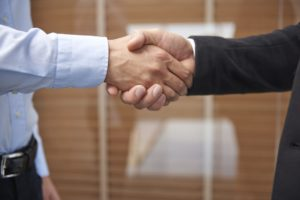 Handshake after signing an important contract